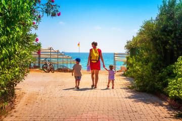 Family go to sea beach