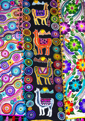 Peruvian traditional colourful native handicraft textile fabric with llama pattern at market in Peru, South Americain. Close up. selective focus