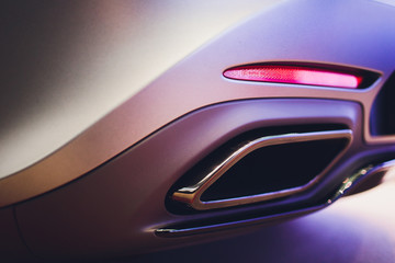 New generation of sportive mufflers. Oval Car Exhaust Tailpipe chromed made of stainless steel on...