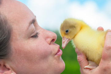 Woman with spring duckling