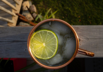 cold drink in copper mug, with a slice of lime