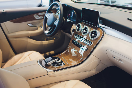 Car modern interior with white leather seats vehicle.