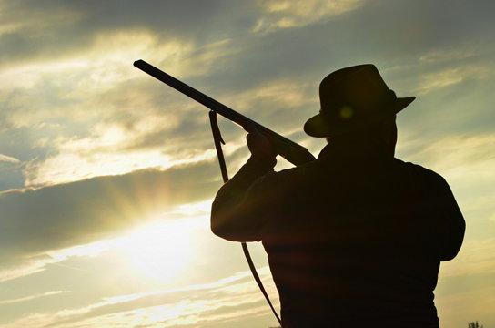 hunter's silhouette, hunter ready to shoot