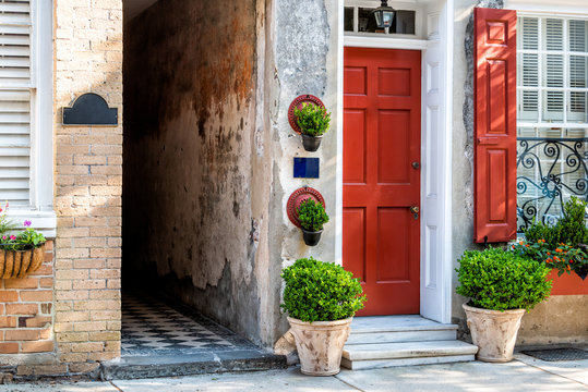 Charleston, USA downtown city street in South Carolina with nobody in southern town by old vintage houses architecture, narrow alley and door entrance