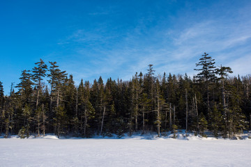 snowy frozen lake with blue skies