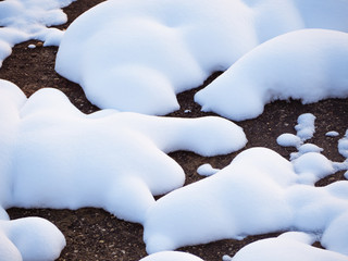 Soft snow patches on dark ground