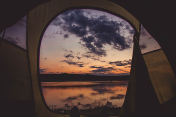 Fishing lake at sunset - view from tent