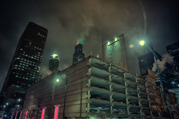 Fototapete - Dark and gritty Chicago city skyline at night during fog