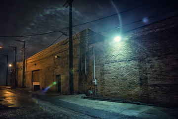 Wall Mural - Dark and eerie industrial urban city street at night in Chicago