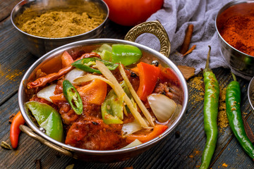kadai chicken indian food or indian curry on wooden background