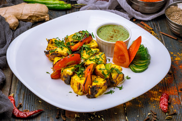 paneer tikka on wooden background indian food