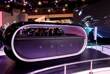 Attendees try out a cabin equipped with Kia R.E.A.D. (Real-time Emotion Adaptive Driving), a system for the cabin of an autonomous vehicle that read emotions of the passengers, during the 2019 CES in Las Vegas