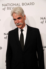 Actor Sam Elliot poses for photographers as he arrives for the National Board of Review Awards gala in New York
