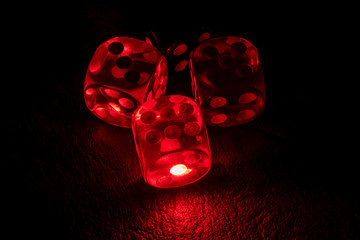 Multi color dice shinning in the dark by soft light