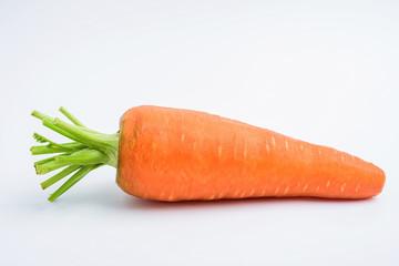 Freshly shaved carrots on white background