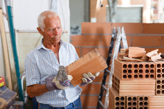 Man working with red brick