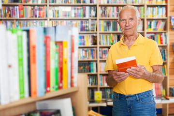 man reading new books