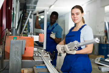 Portrait of woman worker who is occupation near special machine