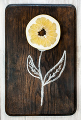 A flower of chalk and citrus. Creative food concept. Vertical.