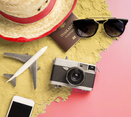Beach Summer Vacation travel accessories and fashion on Sand and pink background