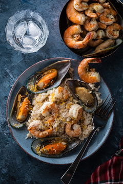 Risotto with seafood. Rice with shrimps and mussels.