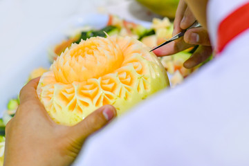Thai fruit carving with hand, Vegetable and Fruit Carving