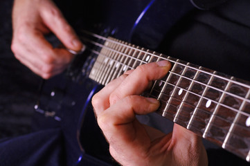 Guitarist hands playing guitar