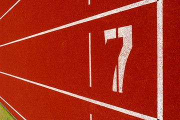 Red treadmill at the stadium with the white numbering