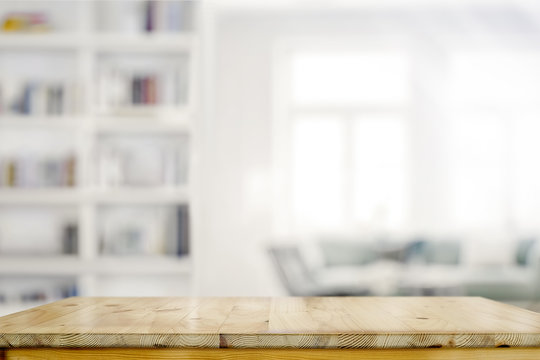 Empty wooden desk table in living room background