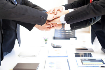 Business people join hands symbol of strong teamwork