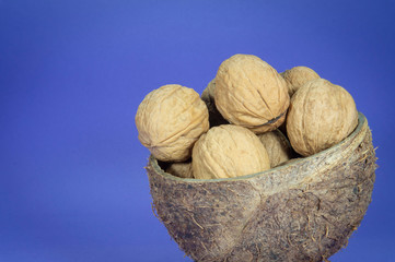 Common walnuts in natural coconut shell cup