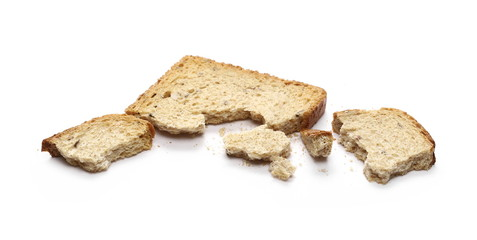 Integral toast slice with linseed and sunflower seeds isolated on white background
