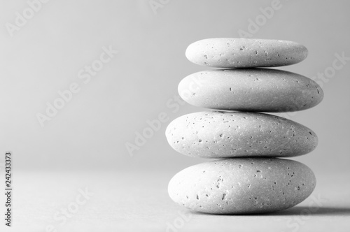 Fototapete Stack of grey massage stones