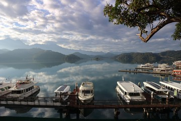 View of Sun Moon Lake with the passenger boats waiting at the numerous piers