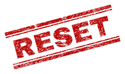 RESET seal print with distress texture. Red vector rubber print of RESET caption with corroded texture. Text label is placed between double parallel lines.