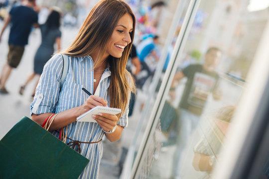 Girl making shopping plans