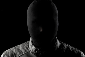 The serial killer, a maniac with a black chuolkom on his head. Halloween concept, psychopath. Copy space. - fototapety na wymiar