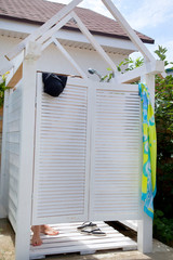 Outdoor shower room in the courtyard. Cabins dressing lockers with white floor