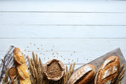 Still life with bread, flour and spikelets