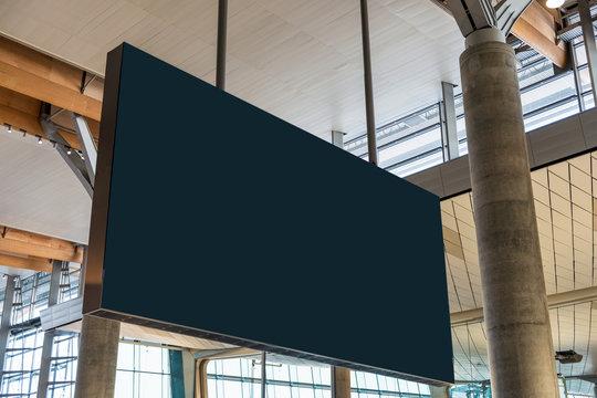 Blank billboard flight information hanging in the airport