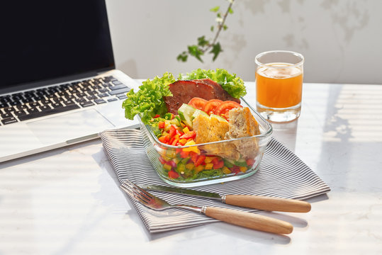Lunch box on work place of working desk ,Healthy eating clean food habits for diet and health care concept