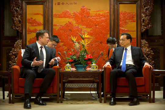 Tesla CEO Elon Musk speaks as Chinese Premier Li Keqiang listens during a meeting at the Zhongnanhai leadership compound in Beijing