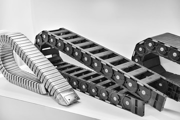 Reinforced plastic towline / industrial processing parts and components