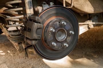 Disc brake of the vehicle for repair,  Car brake repairing in garage.Close up view.
