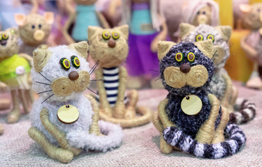 Knitted figures of cats in the gift shop.