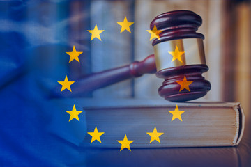 European Union flag with wooden gavel in close-up