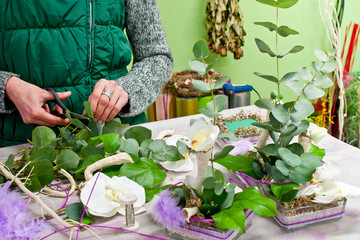 Florist making flowers decoration in her shop