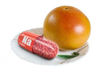 Big Ripe Grapefruit on a white plate