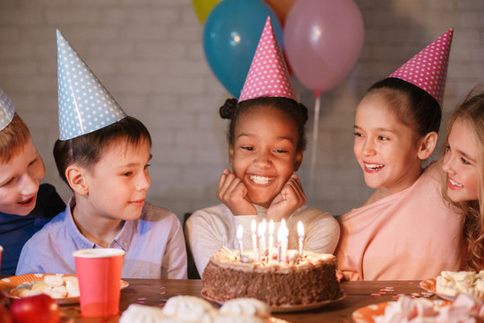 African-american girl having birthday party with friends