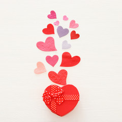 Valentine's day concept. Paper hearts over wooden white background. Flat lay.